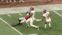 Tony Brown of Alabama ripped away a ball from Javon Wims for an early interception. Photo credit: ESPN
